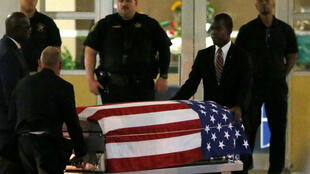 The coffin of US army Sergeant La David Johnson is taken from Christ The Rock Church in Cooper City, Florida