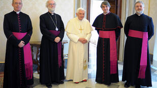 Pope Benedict XVI poses with Archbishop of Canterbury Williams and his delegates during a private meeting at the Vatican