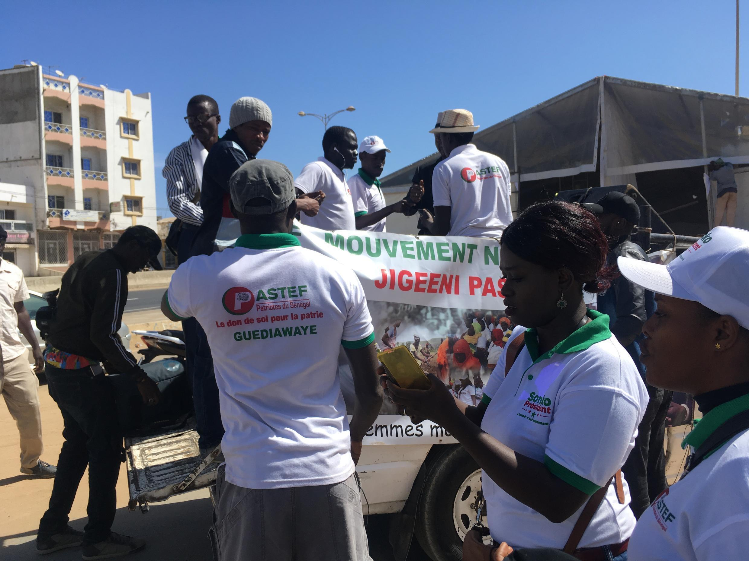 Ousmane Sonko supporters get their float ready for a parade in Dakar.
