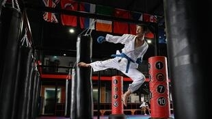 Karate black belt Asif Sultani is now within kicking distance of a spot at the Tokyo Games as part of the refugee team after surviving a life of persecution in Afghanistan and a grim journey to Australia