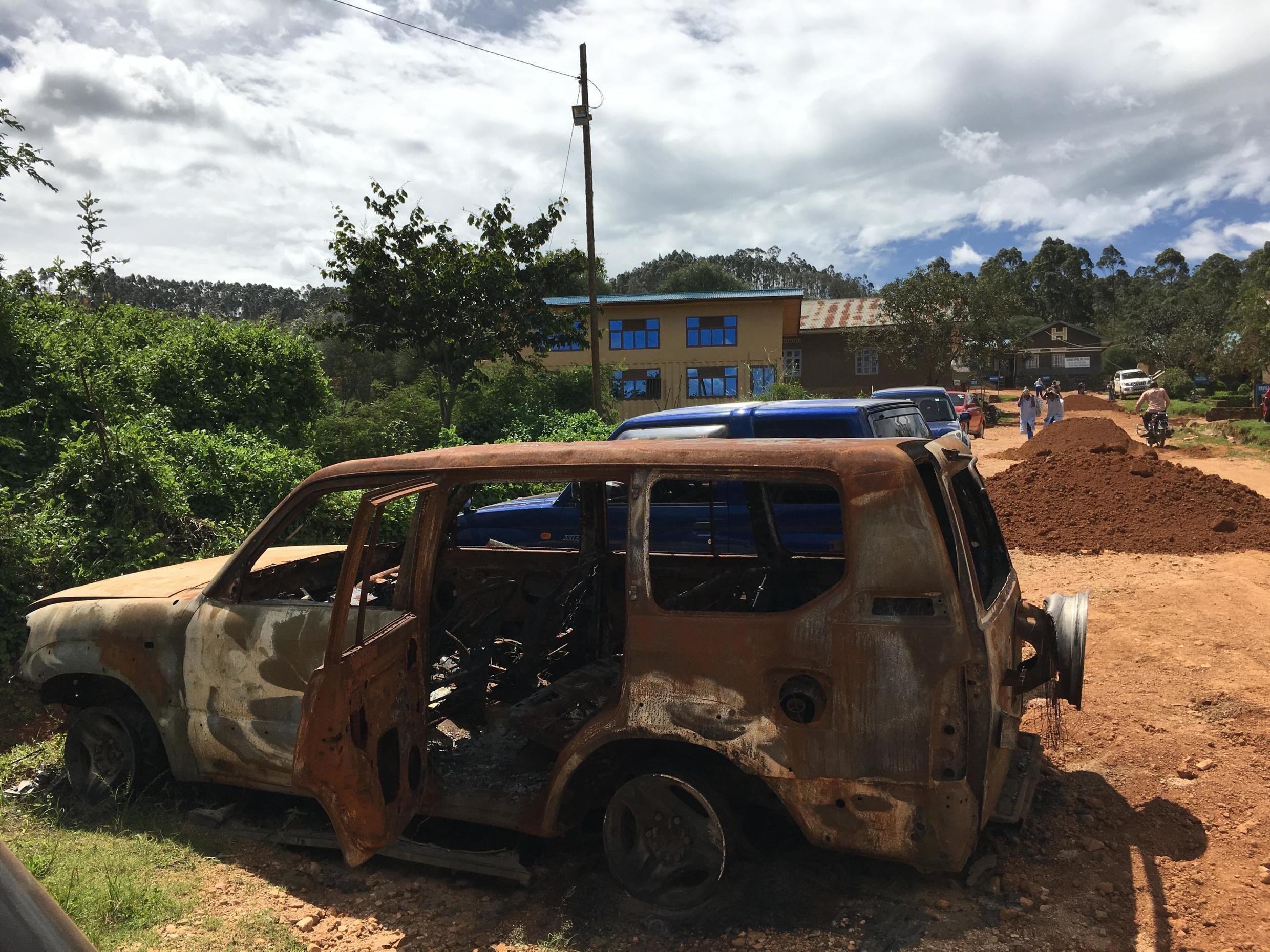 This car was set on fire at Catholic University of Graben hospital, Butembo, DRC, close to where Dr. Richard Valery Mouzoko Kiboung was killed in April