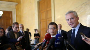French Finance Minister Bruno Le Maire (R) and Minister for Public Action and Accounts Gerald Darmanin (2ndR) talk to journalists to present the French gouvernment's budget at the National Assembly in Paris, France, September 27, 2017.