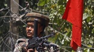 Indian army soldier mans machine gun during flag march in Panthachowk, Srinigar