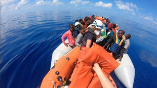 Some of the stranded migrants taken in charge by the Mediterranean rescue vessel Louise Michel, 29 August 2020.