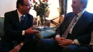 French Socialist leader François Hollande (L) visiting Ahmed Ben Bella in Algiers