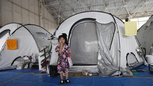 Year of disasters - Four-year-old Rin Itou at a temporary housing centre in northern Japan