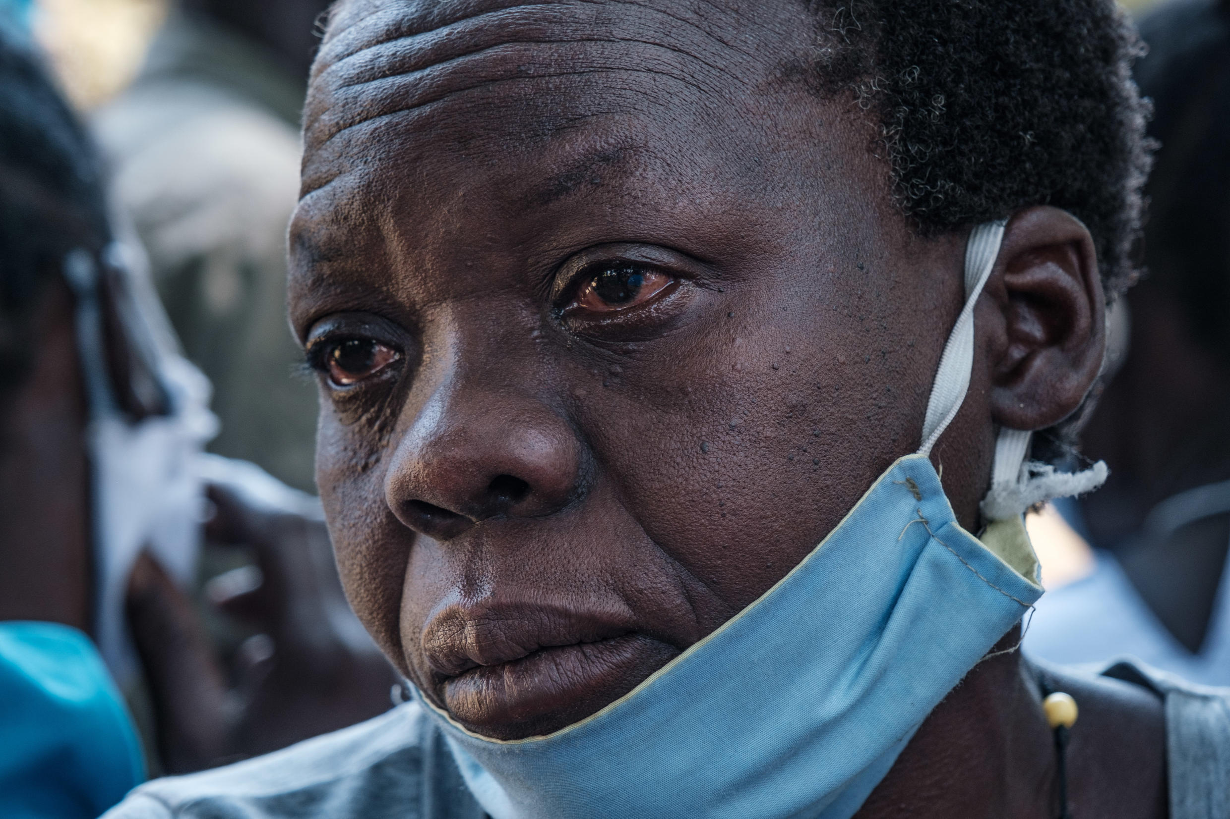 A woman in Lukodi weeps as she listens to the Dominic Ongwen verdict on the radio, 4 February 2021.