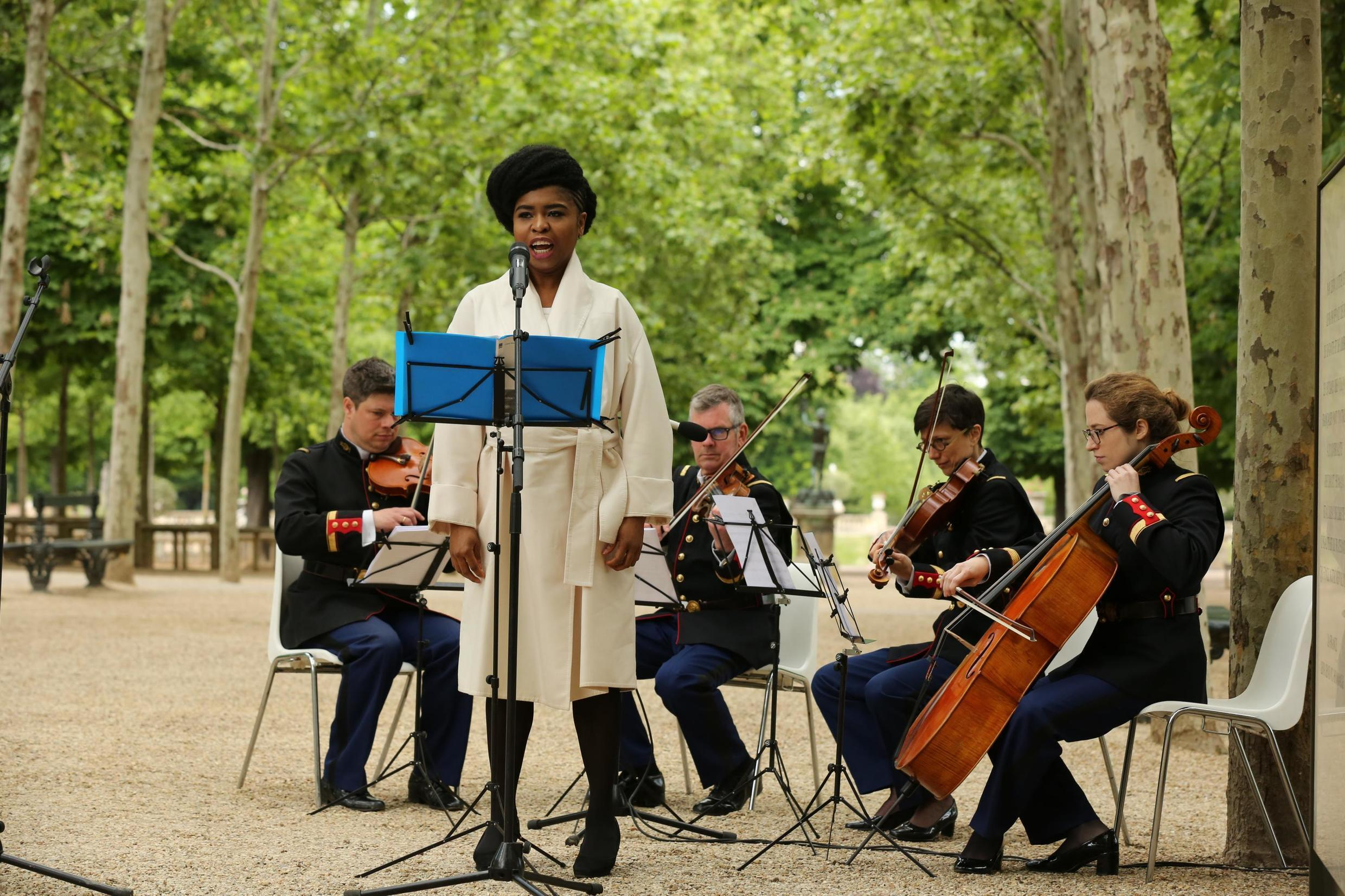 Omo Bello sings an alternative version of the French national anthem in the presence of president Emmanuel Macron on 10 May, 2019, to mark the abolition of slavery in France.