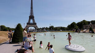 People bathe in a Paris fountain this week
