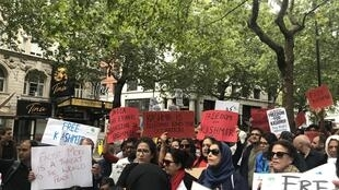 Protesters in London shout slogans during a rally in solidarity with Kashmir after India scrapped the region's special constitutional status, August 10, 2019.