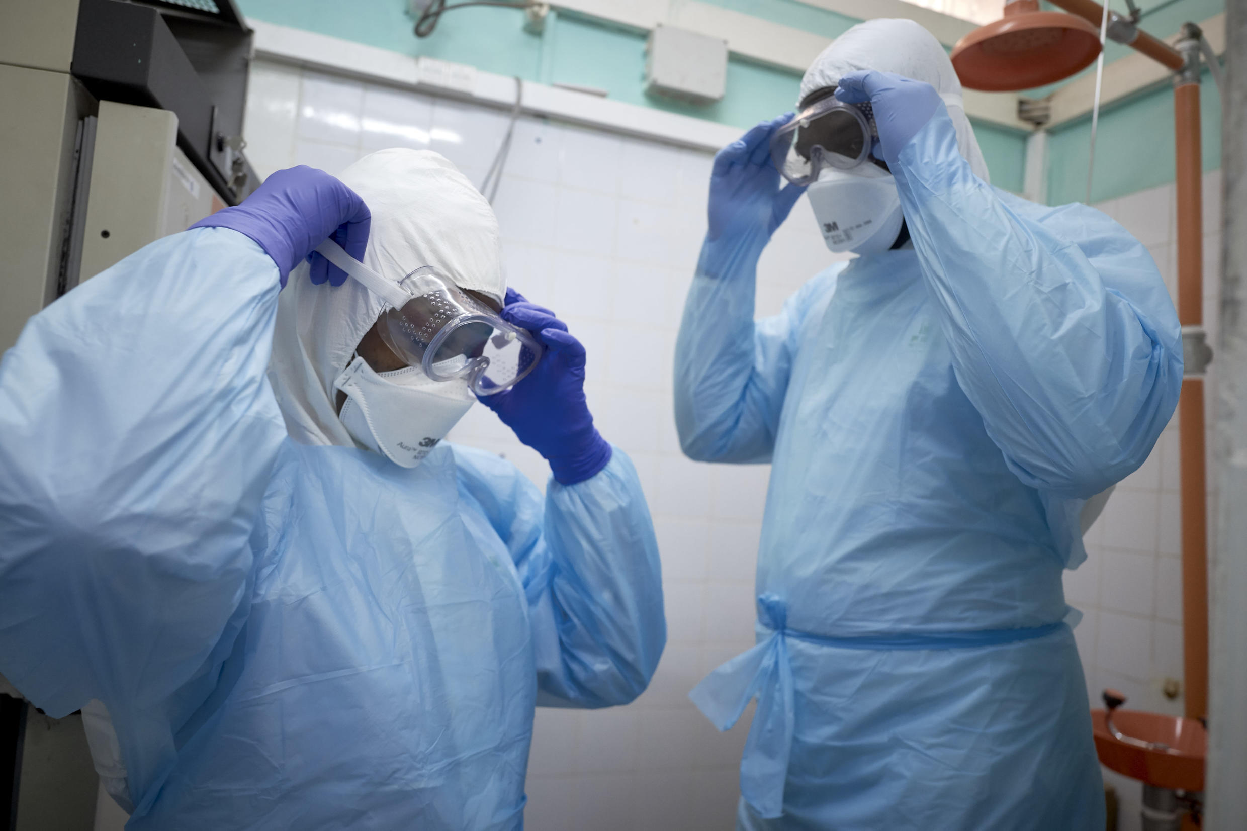 Malian researchers get suited up to conduct a coronavirus test at a lab in Bamako