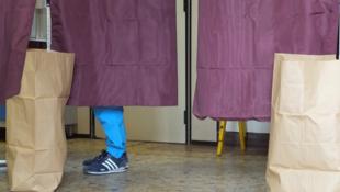 Voting at Collège Jean Poulmarch in Paris's 10th arrondissement