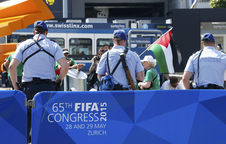 Pro-Palestine protestors demonstrate outside the venue of the 65th FIFA Congress in Zurich, Switzerland