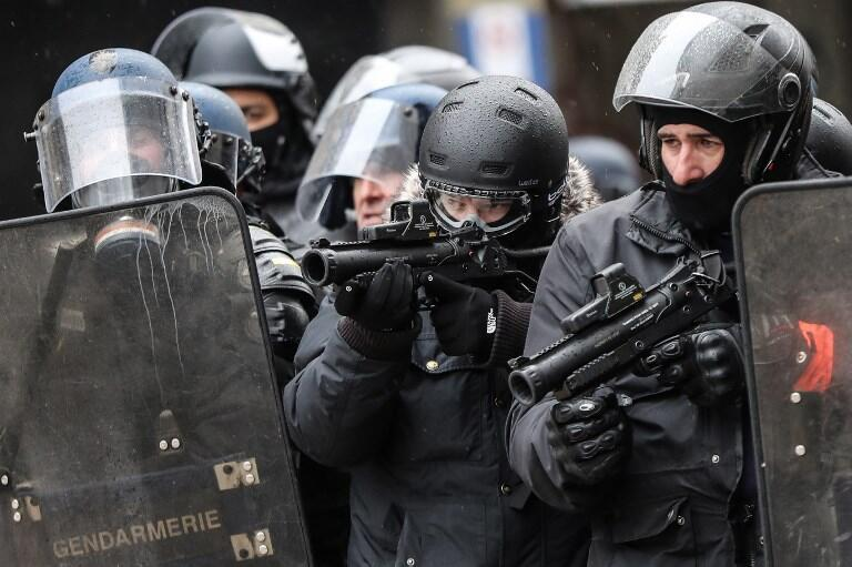 French CRS special police force with anti-riot weapons during demonstrations