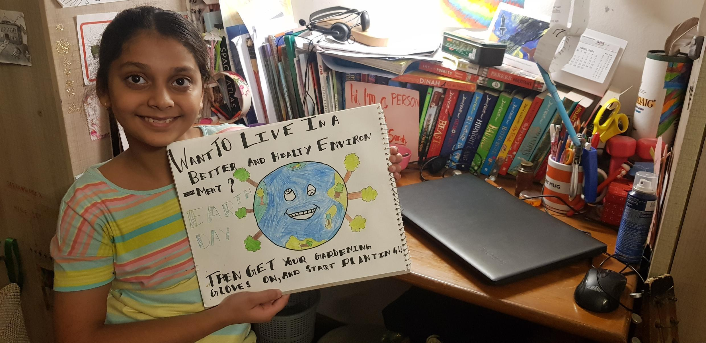 World Earth Day Sarah Rose with poster India