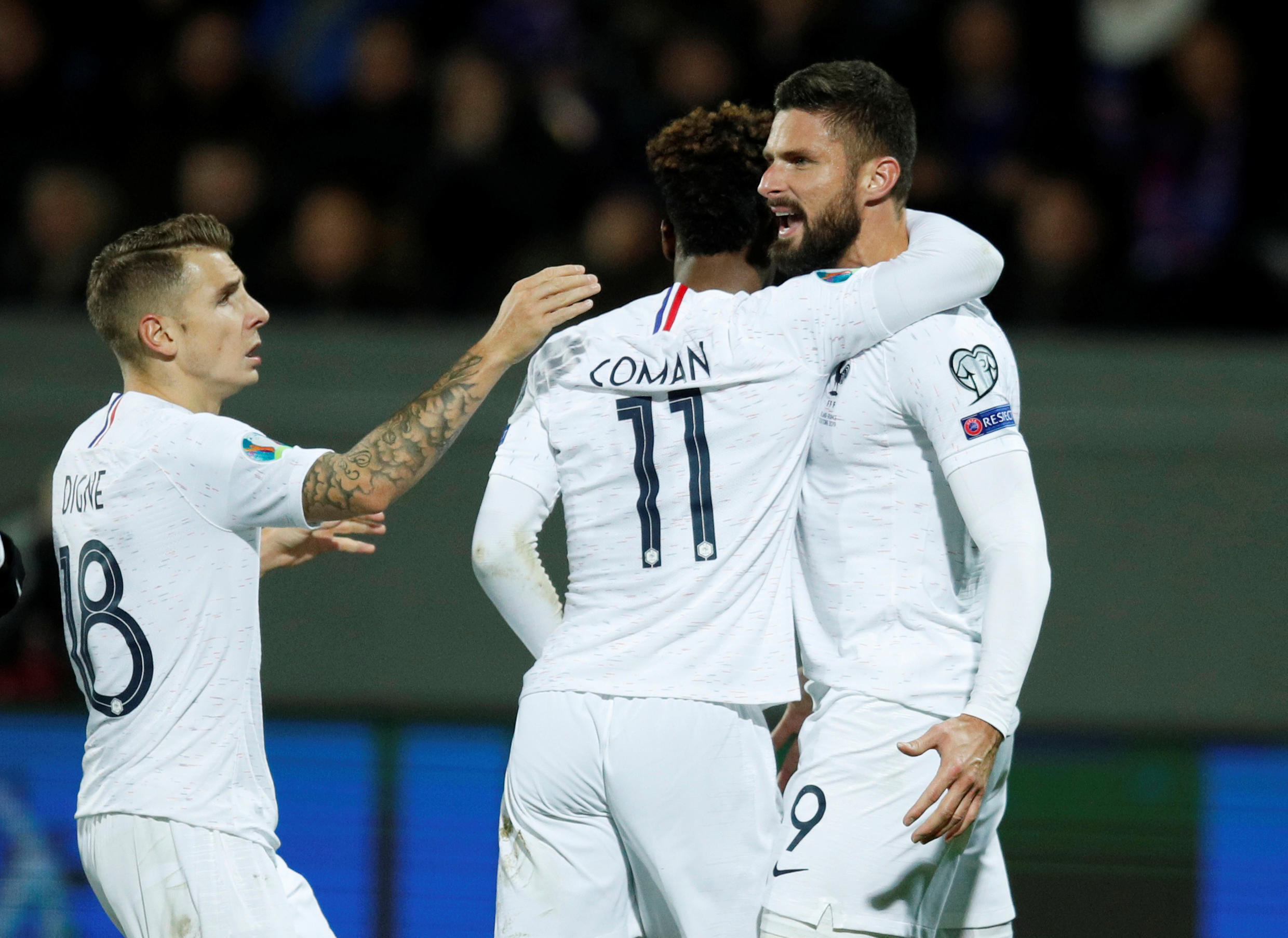 France's Olivier Giroud celebrates scoring their first goal with Kingsley Coman and Lucas Digne, at Euro 2020 qualifying match in Reykjavik, 11 October 2019