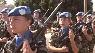 Female soldiers in action with French army contingent of UN forces in Lebanon (2001)