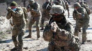 2021-04-14T185019Z_771171628_RC2UVM98G06R_RTRMADP_3_UKRAINE-CRISIS-MILITARY-NATO