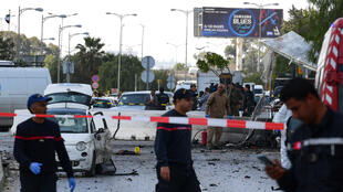 Police and firefighters gather at the scene of an explosion near the US embassy in Tunis on 6 March 2020.