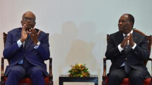 Les présidents burkinabè Roch Marc Christian Kaboré (à gauche) et ivoirien Alassane Ouattara, lors d'un sommet bilatéral à Yamoussoukro, le 29 juillet 2016.