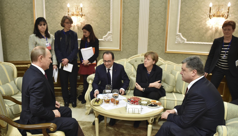 Путин, Олланд, Меркель и Порошенко 11 февраля в Минске.