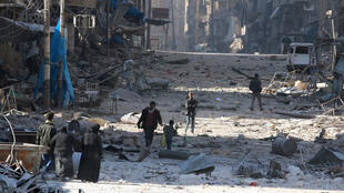 Syrians flee clashes between government forces and rebels in Tariq al-Bab and al-Sakhour in eastern Aleppo