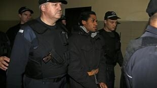 Fritz-Joly Joachin (C) under police escort from a court in the southern city of Haskovo