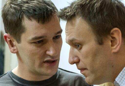 Oleg (L) and Alexei  Navalny were convicted in a 2014 fraud trial related to their work for French cosmetics company Yves Rocher