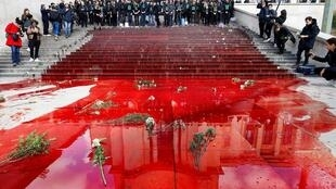 Members of the action group Extinction Rebellion (XR) gather after spilling fake blood on the steps of the Trocadero esplanade during a demonstration to alert on the state of decline of biodiversity, on May 12, 2019 in Paris.
