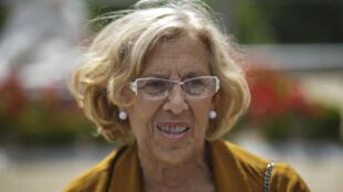 La candidata local de 'Ahora Madrid', Manuela Carmena, posa para los medios, Madrid, 25 de mayo de 2015.
