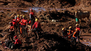 Members of a rescue team search for victims after a tailings dam owned by Brazilian mining company Vale SA collapsed, in Brumadinho, Brazil