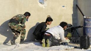 Des rebelles syriens à Alep, le 26 septembre 2013.
