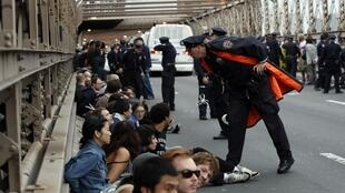 Hundreds arrested during protest march on Brooklyn Bridge