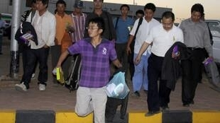 Chinese workers who escaped after being abducted arrive at Khartoum Airport