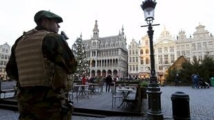 A Belgian soldier patrols on Brussels' Grand Place, December 30, 2015, after two people were arrested in Belgium on Sunday and Monday, both suspected of plotting an attack in Brussels on New Year's Eve, federal prosecutors said.