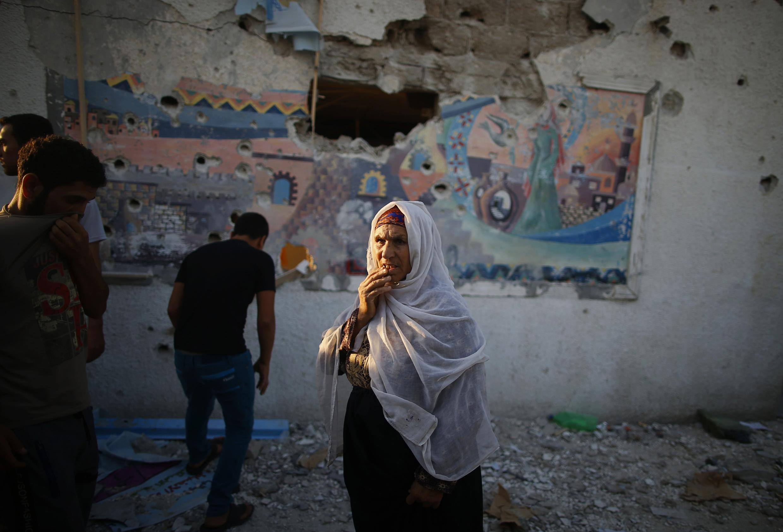Uma palestina na Escola das ONU atingida em Jabalya, Gaza.