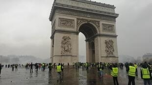 Plumes of smoke and tear gas surrounded the Arc de Triomphe most of Saturday afternoon.