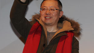 "Chinese filmmaker Wang Chao receiving his ""Cyclo d'Or"" - Golden Rickshaw"