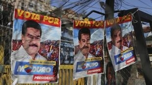 Posters in support of Nicolas Maduro hang in the staunchly Chavista slum of 23 de enero, a stone's throw from the Miraflores presidential palace in Caracas.
