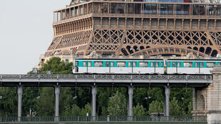 An elevated Paris Metro passes over a bridge next to the Eiffel Tower in Paris, France June 15, 2017.