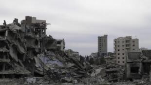 Escombros de prédios na cidade de Homs, uma das cidades mais massacradas pela guerra síria.