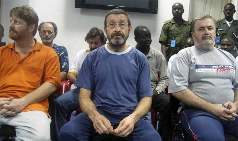 Hostages (L-R) James Robertson from the US, Gilles Mignon from France and Robert Croke from Canada after their release