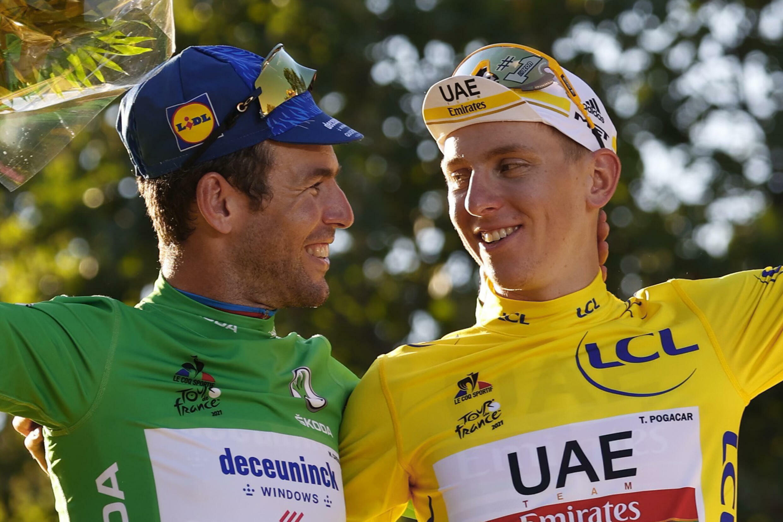 Tour de France winner Tadej Pogacar (right) celebrates with green points jersey winner  Mark Cavendish