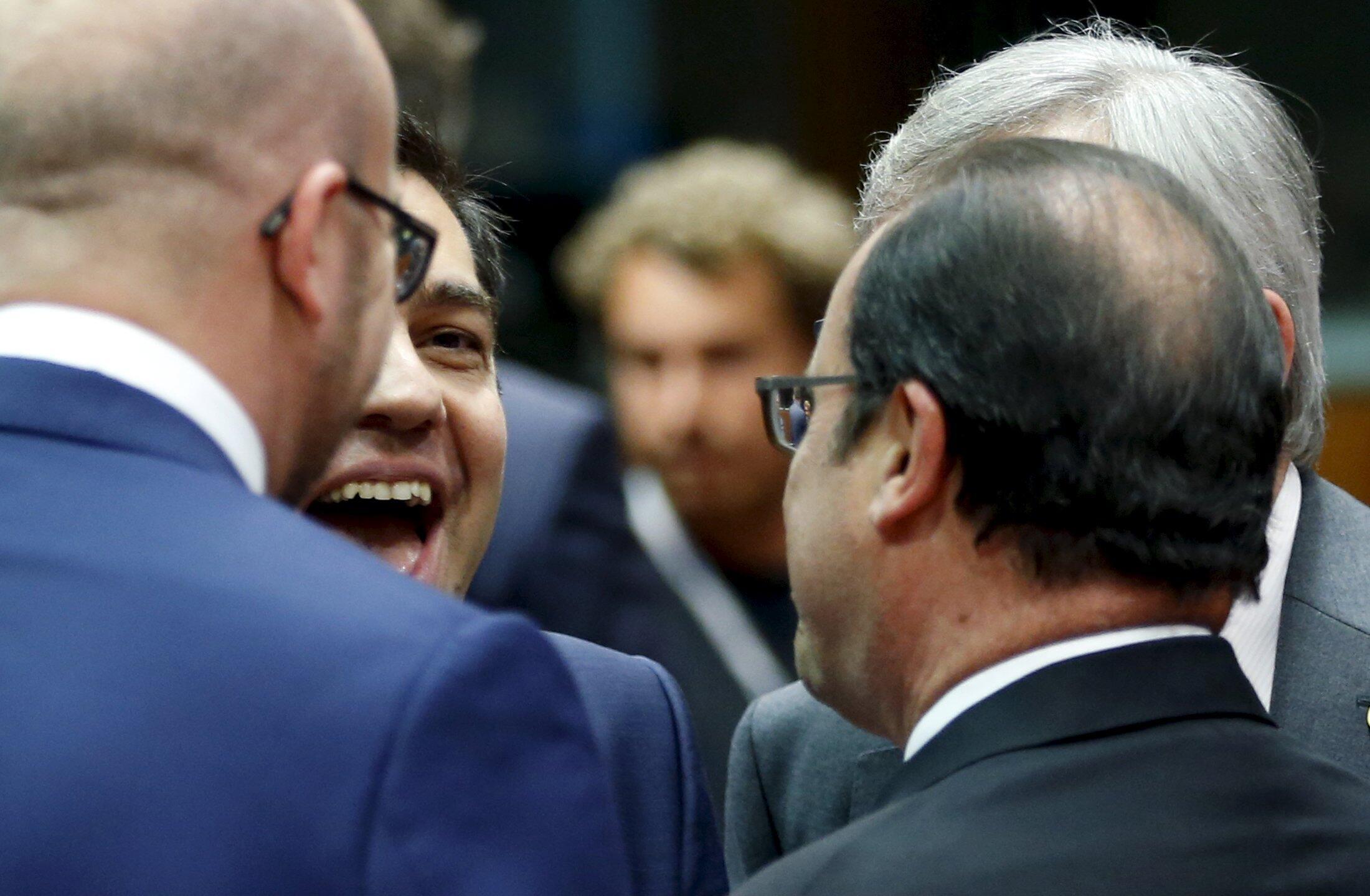 Премьер-министр Греции Алексис Ципрас, глава Еврокомиссии Жан-Клод Юнкер, президент Франции Франсуа Олланд, премьер-министр Бельгии Шарль Мишель на саммите лидеров стран зоны евро, Брюссель, 12 июля 2015 г.