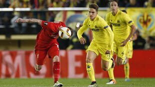 Liverpool's Alberto Moreno in action with Villarreal's Denis Suarez in their Europa League semifinal match on Thursday.