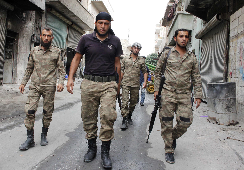 Wapiganaji wa kundi la Liwa al-Islam,linaloshirikiana na jeshi la Syria katika vita dhidi ya waasi.