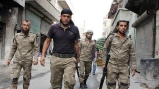 Des combattants de la brigade Liwa al-Islam, qui évoluent dans l'orbite de l'Armée syrienne libre, à Alep, le 19 septembre 2013.