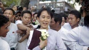 Suu Kyi leaves her NLD's headquarters after meeting ethnic leaders of her party in Yangon