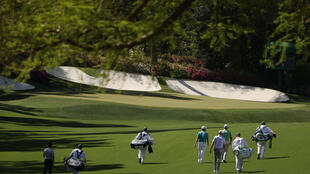 Fast and fiery: Players practise Monday on a resplendent Augusta National course ahead of the first men's major of the year, The Masters