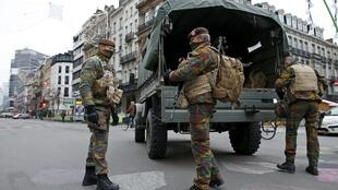 Belgian soldiers patrol in central Brussels as police search the area during a continued high level of security following the recent deadly Paris attacks, Belgium.